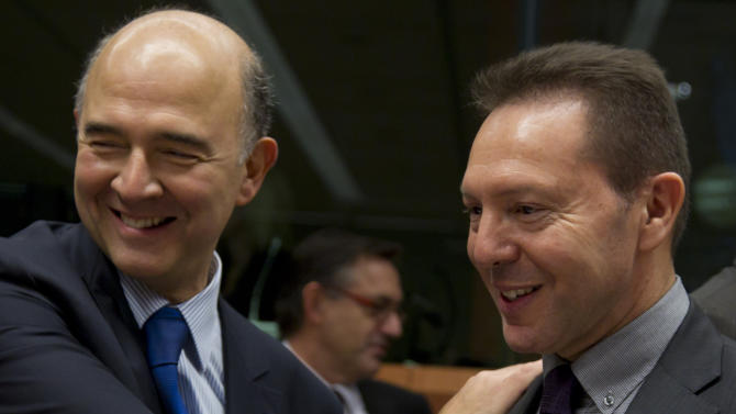 French Finance Minister Pierre Moscovici, left, speaks with Greek Finance Minister Yannis Stournaras during a meeting of eurogroup finance ministers in Brussels on Tuesday, Nov. 20, 2012. European Union officials will make a fresh try Tuesday to reaching a political accord on desperately needed bailout loans to Greece, an agreement that eluded them last week. (AP Photo/Virginia Mayo)