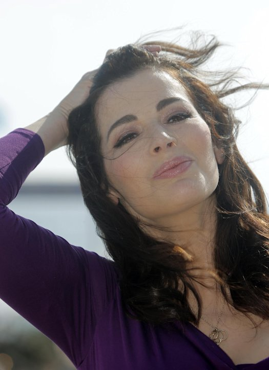 FILE - In this Tuesday, Oct. 9, 2012 file photo, English food writer, journalist and broadcaster, Nigella Lawson poses during the 28th MIPCOM (International Film and Programme Market for Tv, Video,Cab
