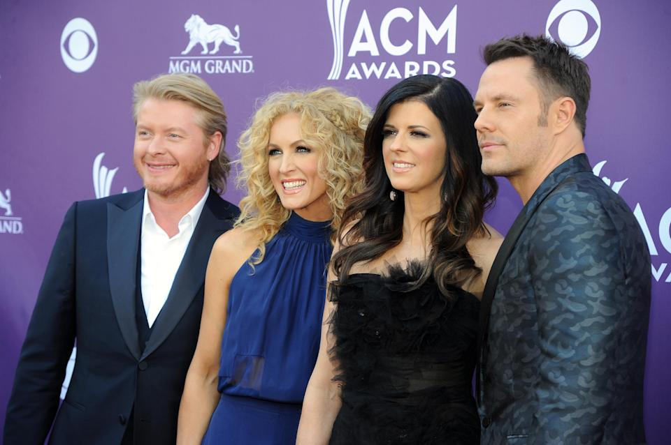 From left, Phillip Sweet, Kimberly Schlapman, Karen Fairchild and Jimi Westbrook, of musical group Little Big Town, arrive at the 48th Annual Academy of Country Music Awards at the MGM Grand Garden Arena in Las Vegas on Sunday, April 7, 2013. (Photo by Al Powers/Invision/AP)