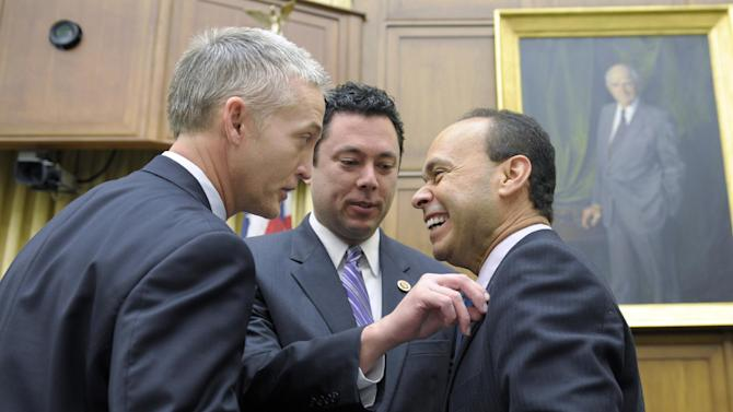 House Judiciary Committee member Rep. Jason Chaffetz, R-Utah, center, adjusts the flag pin on fellow committee member Rep. Luis Gutierrez, D-Ill., right, as they share a laugh with Rep. Trey Gowdy, R-S.C., on Capitol Hill in Washington, Tuesday, Feb. 5, 2013, prior to the committee's hearing on America's Immigration System: Opportunities for Legal Immigration and Enforcement of Laws against Illegal Immigration.  (AP Photo/Susan Walsh)