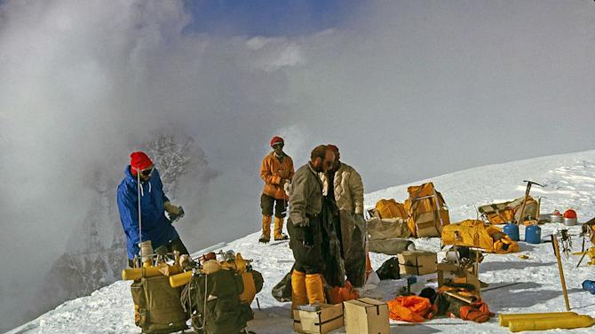 In this 1963 photo released by Henry S. Hall, Jr. American Alpine Club Library, Barry Corbet Personal Papers and Films, members of the 1963 American Mount Everest Expedition team and sherpas are shown with their climbing gear on Mt. Everest. Surviving members of the first American expedition team to reach the top of Mt. Everest are celebrating the 50th anniversary of their mountaineering milestones. Jim Whittaker rweached the top of the world on May 1, 1963, a decade after Britain's Edmund Hillary. Three weeks later, two other Americans, Tom Hornbein and Willi Unsoeld, became the first men ever to scale Everest via more dangerous route on the mountain's west side. (AP Photo/Henry S. Hall, Jr. American Alpine Club Library, Barry Corbet Personal Papers and Films)