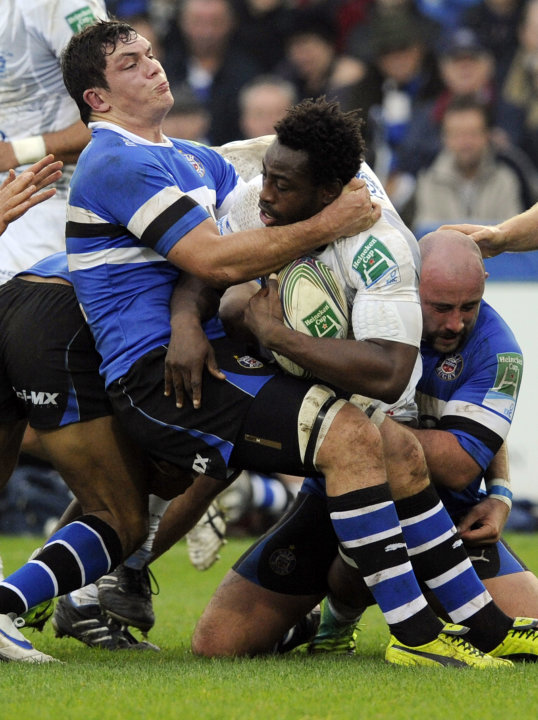 Bath's Francois Louw, left, tackles Montpellier's Remy Martin during their Heineken Cup pool 3 rugby match at the Recreation ground, Bath, England, Sunday, Nov. 20, 2011. (AP Photo/Tom Hevezi)