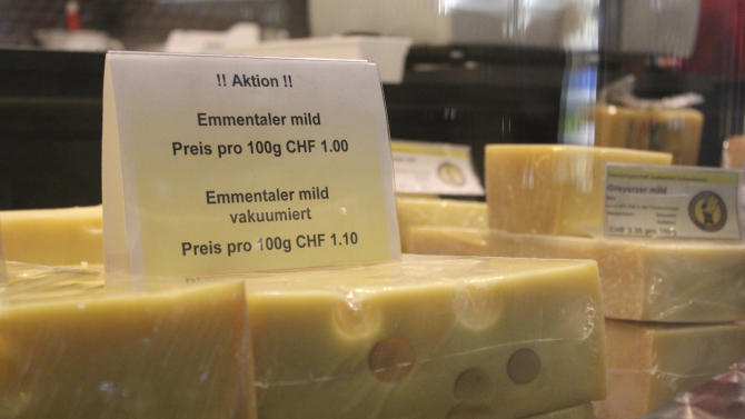 "In this photo taken Tuesday, Aug. 23, 2011, a discount is advertised for Emmental cheese in Affoltern im Emmental, Switzerland. The Emmental Show Dairy cranked out 1.2 million pounds (550 metric tons) of cheese three years ago, but now makes a third less and might be forced to cut back to a few wheels a day _ just to show tourists. The strength of the Swiss franc is driving down profits in this Alpine nation, poking holes in the finances of making Emmental, popularly known as ""Swiss cheese"" in North America.  (AP Photo/Mark D. Carlson)"