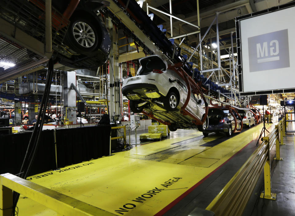 GM 1Q profit falls 14 pct; new pickups key to year