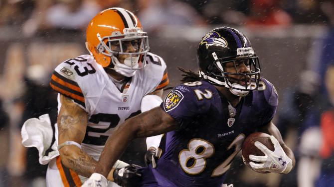 Baltimore Ravens wide receiver Torrey Smith (82) runs for a 32-yard gain as Cleveland Browns cornerback Joe Haden (23) makes the tackle in the third quarter of an NFL football game in the rain on Sunday, Dec. 4, 2011, in Cleveland.  (AP Photo/Amy Sancetta)