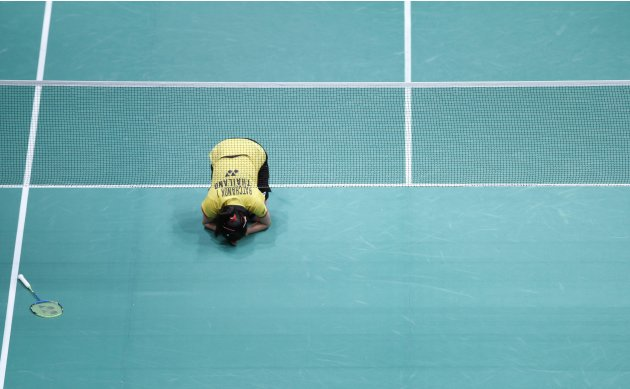 Thailand's Inthanon recites a prayer as she celebrates after winning her women's singles match against Japan's Takahashi in Kuala Lumpur