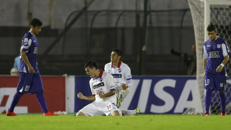 Players of Paraguay's Nacional celebrate after qualifying for the finals of the Copa Libertadores in Montevideo