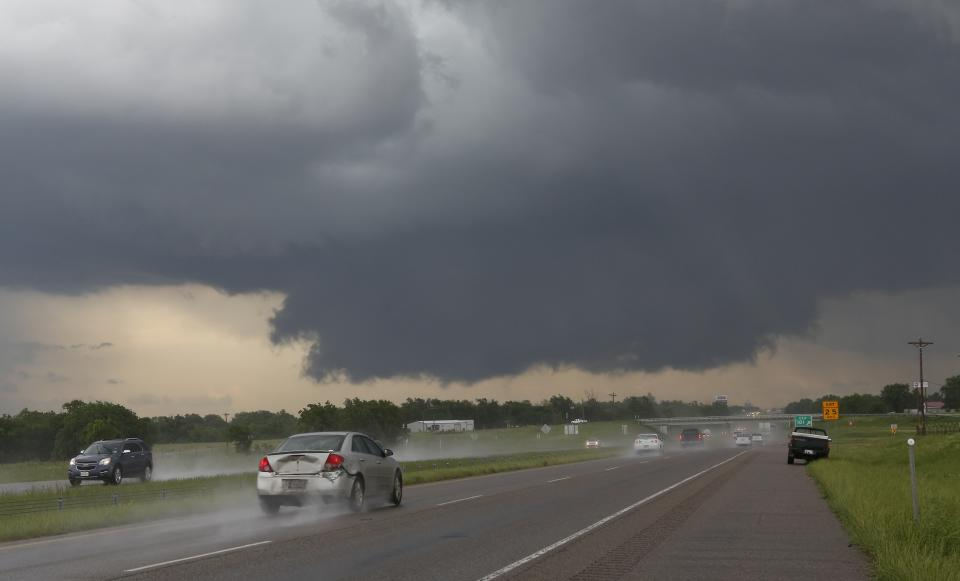 A wall cloud forms near Interstate 35 and Purcell, Okla. on Thursday, May 30, 2013. At least two tornadoes touched down in Oklahoma and another hit Arkansas on Thursday as a powerful storm system moved through the middle of the country. At least nine injuries were reported. (AP Photo/Alonzo Adams)