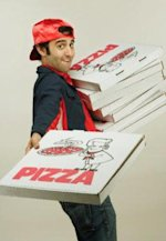 A pizza guy making deliveries.