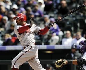 Cahill pitches Diamondbacks past Rockies 5-2