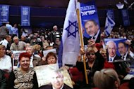 <p>Supporters hold posters of Israeli Prime Minister Benjamin Netanyahu (L) and Foreign Minister Avigdor Lieberman during the launch of the Likud-Beitenu elections campaign on December 25, 2012 in Jerusalem.</p>