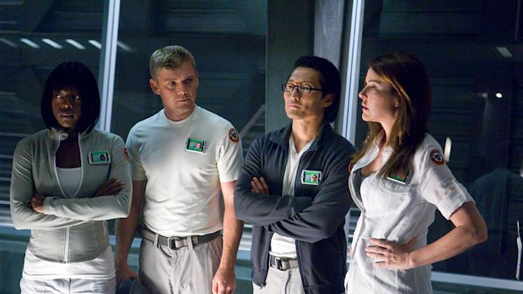 "Viola Davis as Dr. Charlene Barton, Ricky Schroder as Major Keene M.D., Daniel Dae Kim as Dr. Tsi Chou, and Christa Miller as Dr. Angela Noyce in A&E's original mini-series ""The Andromeda Strain."""
