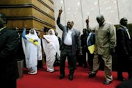 Sudanese President Omar al-Bashir (C) arrives at Khartoum&#39;s Friendship Hall to address a working women&#39;s state organisation. Nine days of country-wide protests against high prices in Sudan are no &quot;Arab Spring&quot;, Bashir said on Sunday, referring to a series of uprisings against regional strongmen