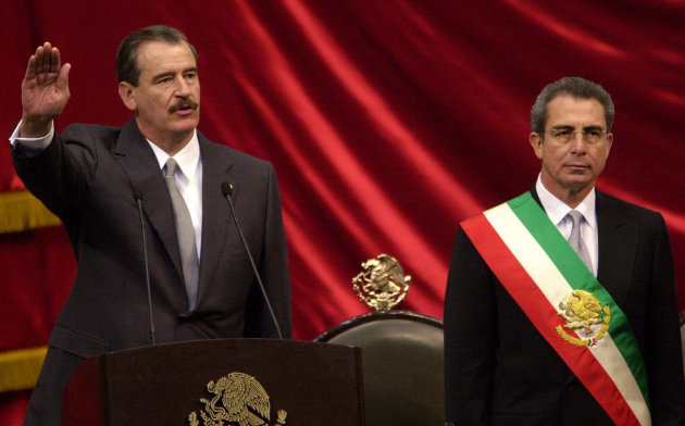 FILE - In this Friday Dec. 1, 2000 file photo, Mexican President-elect Vicente Fox, left, takes the oath of office as outgoing Mexican President Ernesto Zedillo listens during the inauguration ceremony at the National Congress in Mexico City. Mexicans hoped that their country would take a new course under Vicente Fox&#39;s center-right National Action Party, or PAN, but despite a more open economy and a bigger middle class, Mexico is torn by drug trafficking violence after a dozen years under the PAN&#39;s leadership, first under Fox and then under current President Felipe Calderon, who barely squeaked by in contested 2006 elections. (AP Photo/Dario Lopez-Mills, File)