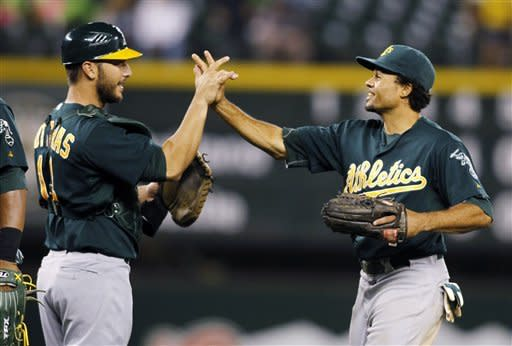 Kottaras homers again, A's beat Mariners 6-1