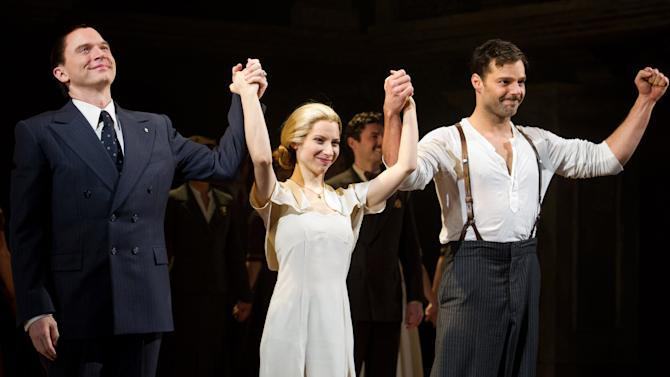 "FILE - This March 12, 2012 file photo shows actors, from left, Michael Cerveris, Elena Roger and Ricky Martin at the curtain call after their first performance in the new Broadway production of ""Evita"", in New York. Cerveris, Roger and Martin will perform their final performances on Jan. 26, 2013.  (AP Photo/Charles Sykes, file)"