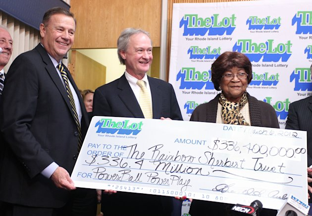Louise White, right, 81 from Newport, R.I., is presented a check for $336 million by Gerald Aubin, left, director of the state's lottery, and Gov. Lincoln Chafee, center, at Rhode Island Lottery headq