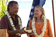 US Secretary of State Hillary Clinton (R) receives gifts from Cook Islands PM Henry Puna during the Pacific Islands Forum in Rarotonga, Cook Islands, on August 31. Clinton was heading Sunday from the Cook Islands to Indonesia before she meets China&#39;s leaders in Beijing
