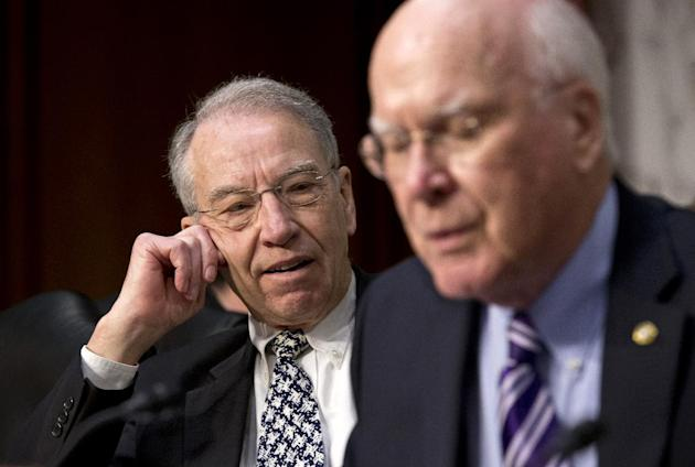 Sen. Chuck Grassley, R-Iowa, ranking member on the Senate Judiciary Committee, left, pauses after a brief but heated response to remarks by Sen. Chuck Schumer, D-N.Y., not pictured, during the committ