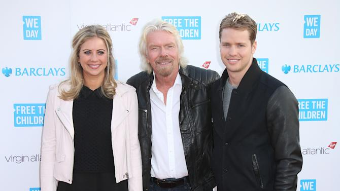 Holly Branson, Richard Branson and Sam Branson pose for photographers on arrival We Day UK at Wembley Arena, in west London, Thursday, March 5, 2015. With 12,000 students and teachers in attendance from more than 550 schools, We Day celebrates the potential of young people to implement local and global changes. (Photo by Joel Ryan/Invision/AP)