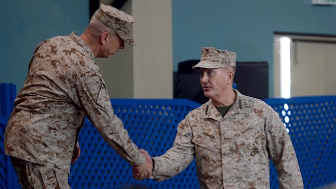 U.S. Marine Gen. Joseph F. Dunford, right, shakes hand with outgoing NATO commander U.S. Gen. John Allen, left, during a change of command ceremony at the ISAF headquarters in Kabul, Afghanistan, Sunday, Feb. 10, 2013. Dunford takes charge at a critical time for President Barack Obama and the military as foreign combat forces prepare to withdraw by the end of 2014. (AP Photo/Massoud Hossaini, Pool)