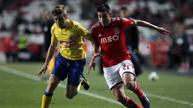 Benfica's Nico Gaitan, from Argentina, tussles for the ball with Arouca's Ivan Balliu, from Spain, left, during a Portuguese league soccer match between Benfica and Arouca at Benfica's Luz stadium in Lisbon, Friday, Dec. 6, 2013