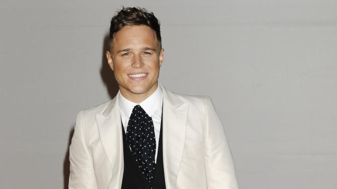 Singer Olly Murs arrives for the Brit Awards 2012 at the O2 Arena in London, Tuesday, Feb. 21, 2012. (AP Photo/Jonathan Short)
