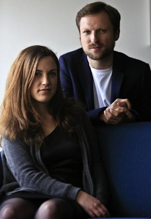 """Journalist Melanie Gouby, left, and filmmaker Orlando von Einsiedel pose before their interview about the film """"Virunga,"""" Thursday April 17, 2014 in New York. The film about Virunga National Park in eastern Congo debuts at the Tribeca Film festival on Thursday. (AP Photo/Bebeto Matthews)"""