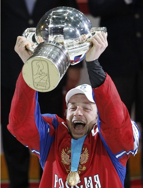 Russia's Nikulin celebrates with the trophy after winning their 2012 IIHF men's ice hockey World Championship final game against Slovakia in Helsinki