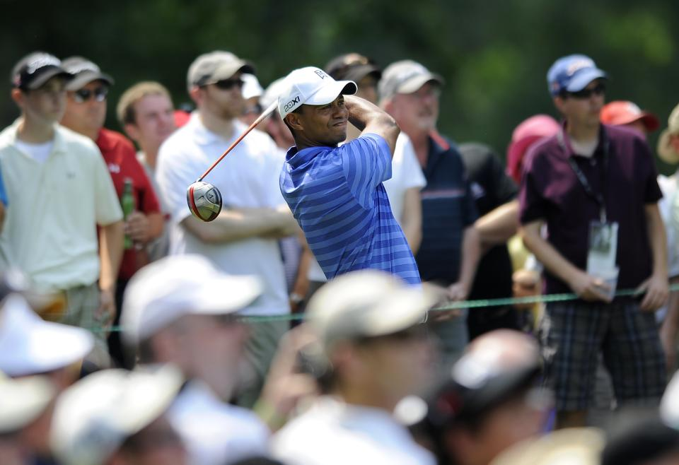 Tiger Woods watches his drive from the fourth tee during the second round of the AT&T National golf tournament at Congressional Country Club in Bethesda, Md., Friday, June 29, 2012. (AP Photo/Nick Wass)