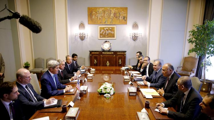 U.S. Secretary of State John Kerry, center left, and Egypt's Foreign Minister Sameh Shukri, center right, are seated with their delegations during an expanded meeting in Cairo, Egypt, Tuesday, July 22, 2014. Kerry has returned to the Middle East as the Obama administration attempts to bolster regional efforts to reach a ceasefire and sharpens its criticism of Hamas in its conflict with Israel. (AP Photo/Pool)