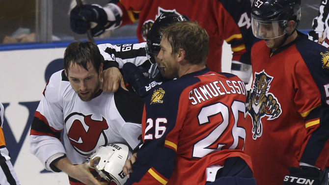 Florida Panthers' Mikael Samuelsson (26) exchanges words with New Jersey Devils' Travis Zajac, left, as Zach Parise is trapped below during the second period of Game 7 in a first-round NHL Stanley Cup playoff hockey series, in Sunrise, Fla., Wednesday, April 26, 2012. (AP Photo/J Pat Carter)