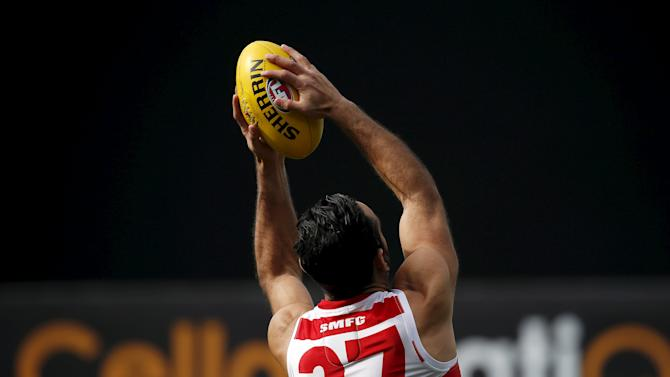 Aboriginal activist and Australian Rules Football legend Goodes reaches to catch a ball during a team training session at the Sydney Cricket Ground