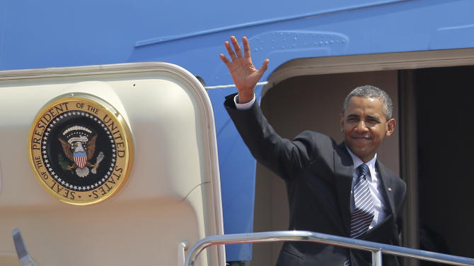 President Barack Obama waves as he boards Air Force One at Haneda Airport in Tokyo, Friday, April 25, 2014, en route to Osan Air Base in Osan, South Korea. (AP Photo/Eugene Hoshiko)