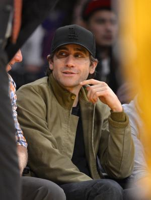 Actor Jake Gyllenhaal watches the Los Angeles Lakers play the Minnesota Timberwolves during the first half of an NBA basketball game, Sunday, Nov. 10, 2013, in Los Angeles. (AP Photo/Mark J. Terrill)