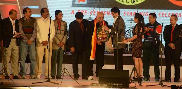 Former India cricket captain Sourav Ganguly felicitated former East Bengal footballers during East Bengal Club's Pre-Centenary celebrations in Kolkata on Dec. 21, 2013. (Photo: IANS)