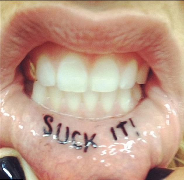 Celebrity photos: Singer Ke$ha got a new tattoo this week – on the inside of her lip. Ouch. The star tweeted an image of the inking which reads 'Suck it.' Copyright [Ke$ha]