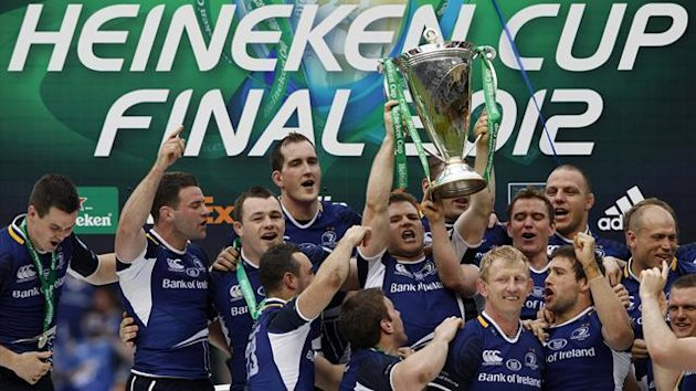 Leinster&#39;s rugby players celebrate with the trophy after they won the Heineken Cup final rugby match against Ulster at Twickenham Stadium in London (Reuters)