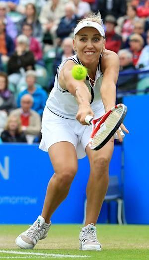 Russia's Elena Vesnina on her way to victory over China's Na Li during the AEGON International at Devonshire Park, Eastbourne, England Thursday June 20, 2013. (AP Photo/Gareth Fuller/PA) UNITED KINGDOM OUT NO SALES NO ARCHIVE
