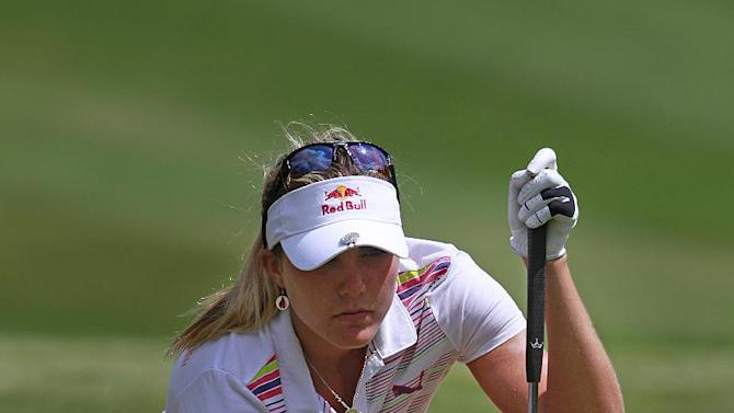 Lexi Thompson sets her ball on ninth green during the third round of the Mobile Bay LPGA Classic golf tournament, Saturday, April 28, 2012, in Mobile, Ala. (AP Photo/Press-Register, Bill Starling) MAGS OUT