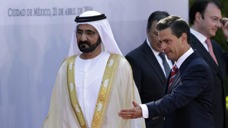 Enrique Pena Nieto and Sheikh Mohammed Bin Rashid Al Maktoum arrive to attend they a review the honour guard during an official welcoming ceremony for Al Maktoum at the L