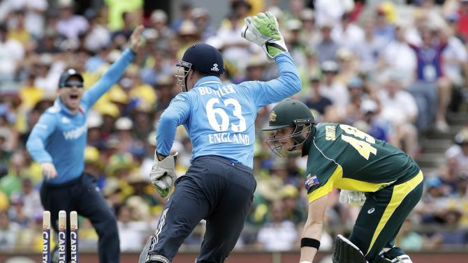 Australia's Steven Smith is stumped by England's Jos Buttler during their One Day International tri-series cricket final match at the WACA ground