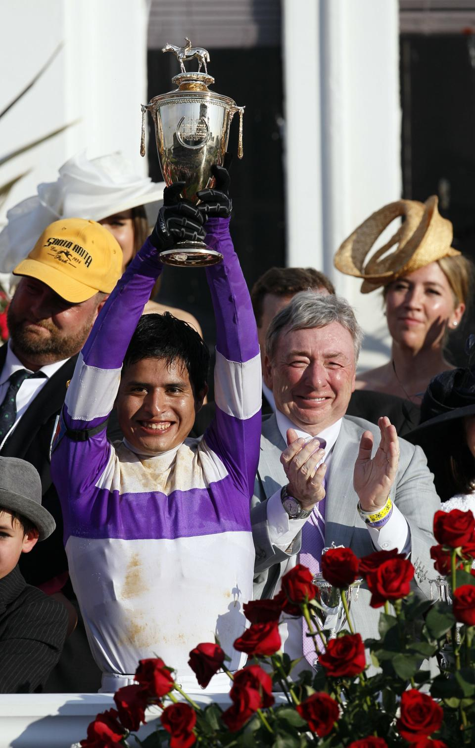 Jockey Mario Gutierrez reacts with owner J. Paul  Reddam after riding I'll Have Another to victory in the 138th Kentucky Derby horse race at Churchill Downs Saturday, May 5, 2012, in Louisville, Ky. (AP Photo/Mark Humphrey)
