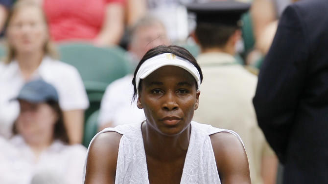 Venus Williams of the US sits in her chair in the break between games duirng the match against Bulgaria's Tsvetana Pironkova at the All England Lawn Tennis Championships at Wimbledon, Monday, June 27, 2011. (AP Photo/Kirsty Wigglesworth)