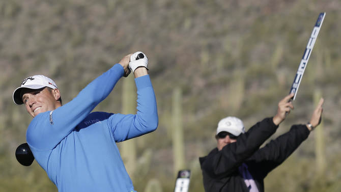 Alexander Noren of Sweden tees off against Graeme McDowell of Northern Ireland during extra holes in the second round of play during the Match Play Championship golf tournament, Friday, Feb. 22, 2013, in Marana, Ariz. McDowell won 1 up in 20 holes. (AP Photo/Ted S. Warren)