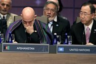 Afghan President Hamid Karzai (L) and UN Secretary General Ban Ki-moon attend a meeting at the NATO summit in Chicago, Illinois. Karzai sought to reassure nervous allies that the sacrifices made on all sides would not have been vain, maintaining Taliban Islamic militants could not recapture power