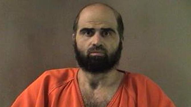 FILE - This undated file photo provided by the Bell County Sheriff's Department via The Temple Daily Telegram shows Nidal Hasan, the Army psychiatrist charged in the deadly 2009 Fort Hood shooting rampage. A military appeals court has thrown out a judge's order to forcibly shave the Fort Hood shooting suspect and removed the judge from the case. The U.S. Court of Appeals for the Armed Forces ruled Monday, Dec. 3, 2012 that Col. Gregory Gross didn't appear impartial while presiding over the case of Maj. Nidal Hasan. (AP Photo/Bell County Sheriff's Department via The Temple Daily Telegram, File)
