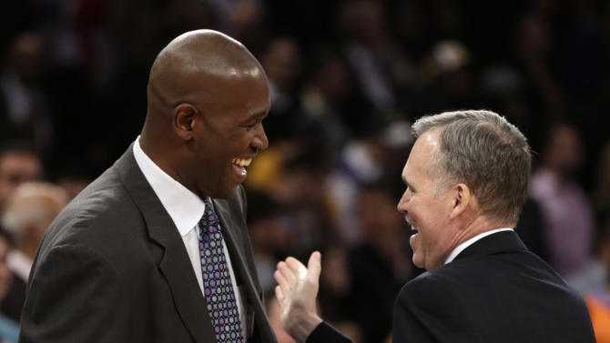 Los Angeles Lakers head coach Mike D'Antoni, right, greets former assistant Herb Williams before the Lakers faced the New York Knicks in an NBA basketball game at Madison Square Garden in New York, Thursday, Dec. 13, 2012.  It was the first time D'Antoni returned to the Garden after resigning as head coach of the New York Knicks. (AP Photo/Kathy Willens)