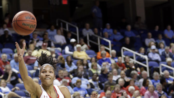 Maryland's Alyssa Thomas (25) drives past Wake Forest's Chelsea Douglas (5) during the first half of an NCAA college basketball game at the Atlantic Coast Conference tournament in Greensboro, N.C., Friday, March 8, 2013. (AP Photo/Chuck Burton)