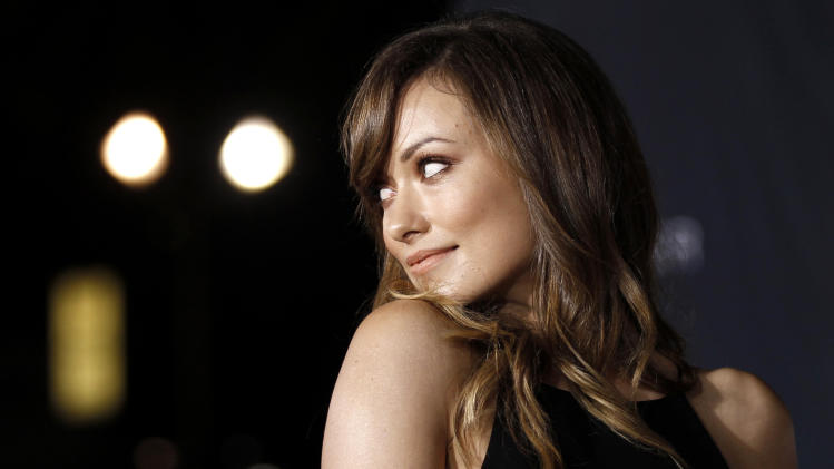 "Cast member Olivia Wilde arrives at the premiere of ""In Time"" in Los Angeles, Thursday, Oct. 20, 2011.  ""In Time"" opens in theaters Oct. 28, 2011. (AP Photo/Matt Sayles)"